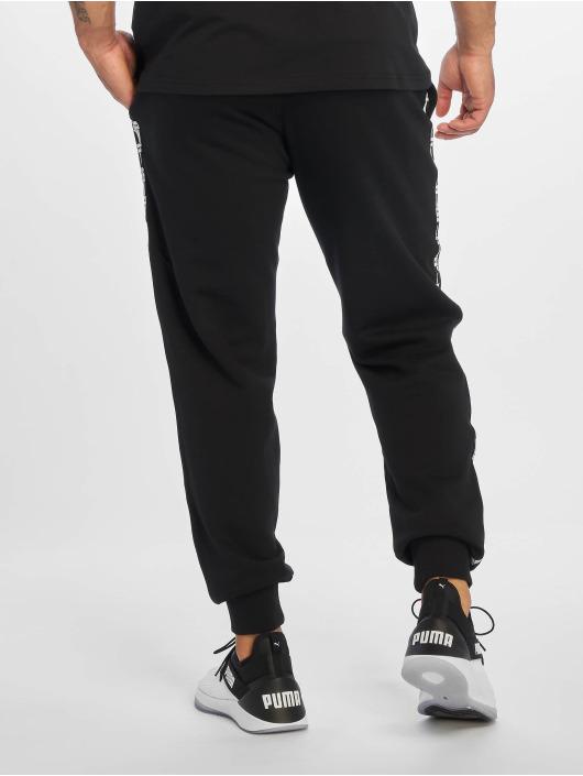 Puma Spodnie do joggingu XTG Cuff czarny