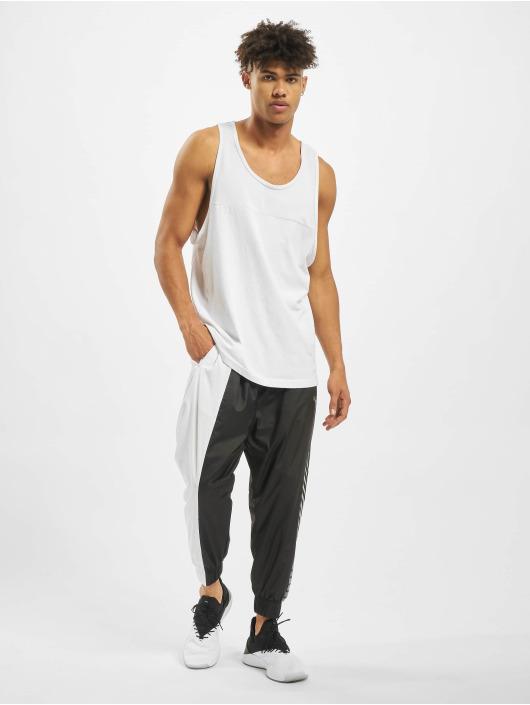 Puma Spodnie do joggingu Collective Woven Sweat czarny