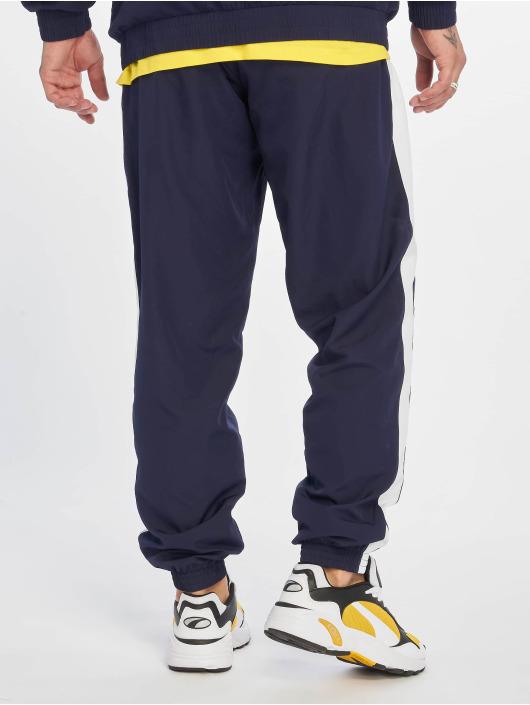 Puma Spodnie do joggingu Iconic T7 niebieski