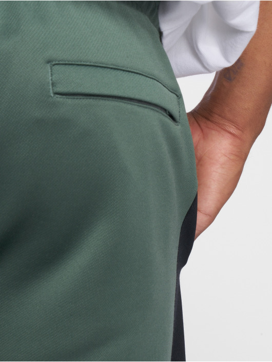 Puma Spodnie do joggingu Classics T7 oliwkowy