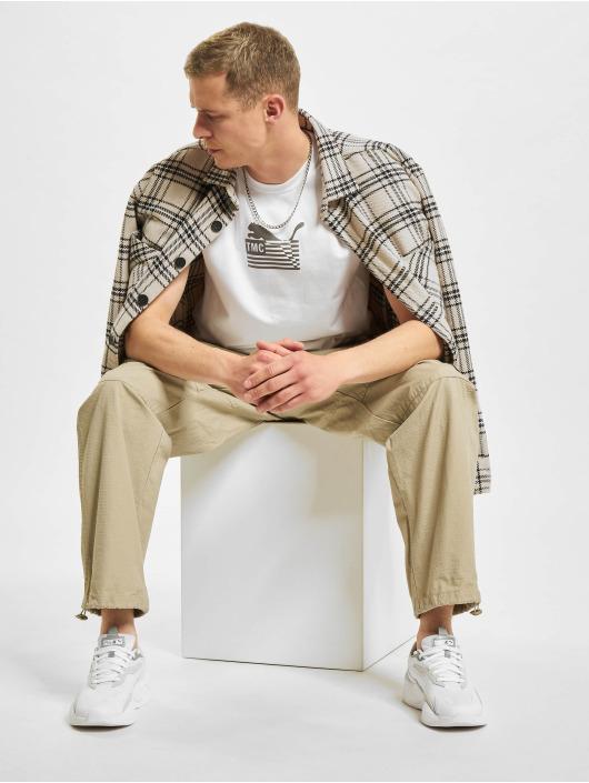 Puma T-Shirt TMC Hussle Way Logo blanc