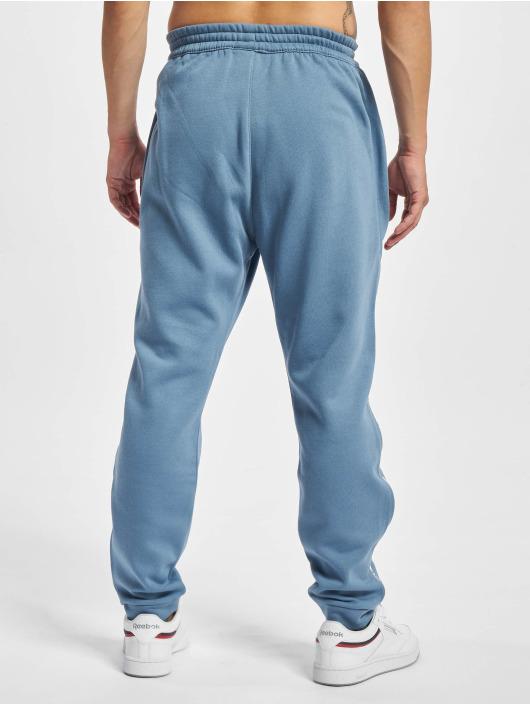 Reebok Spodnie do joggingu TE Piping niebieski