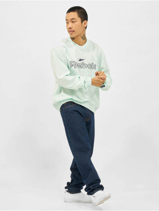 Reebok Swetry CL TS Woven Crew niebieski