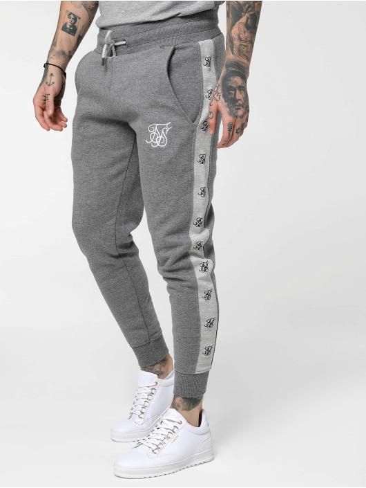 Sik Silk Jogging kalhoty Muscle šedá