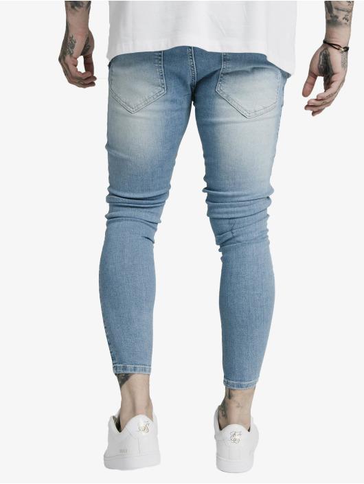 Sik Silk Skinny Jeans Distresed niebieski