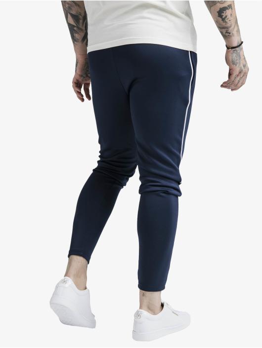 Sik Silk Spodnie do joggingu Agility Deluxe niebieski