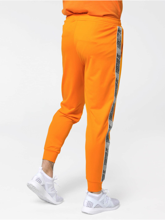 Sik Silk Spodnie do joggingu Cuffed Cropped Runner pomaranczowy