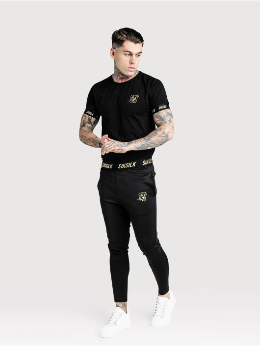 Sik Silk t-shirt Golden Reflect Raglan Tech zwart