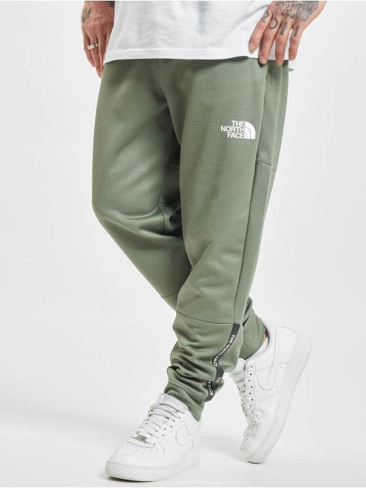 The North Face Spodnie do joggingu Ma zielony