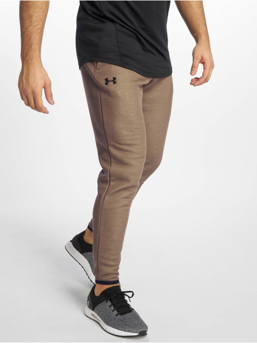 Under Armour Jogger Pants Unstoppable Move hnedá
