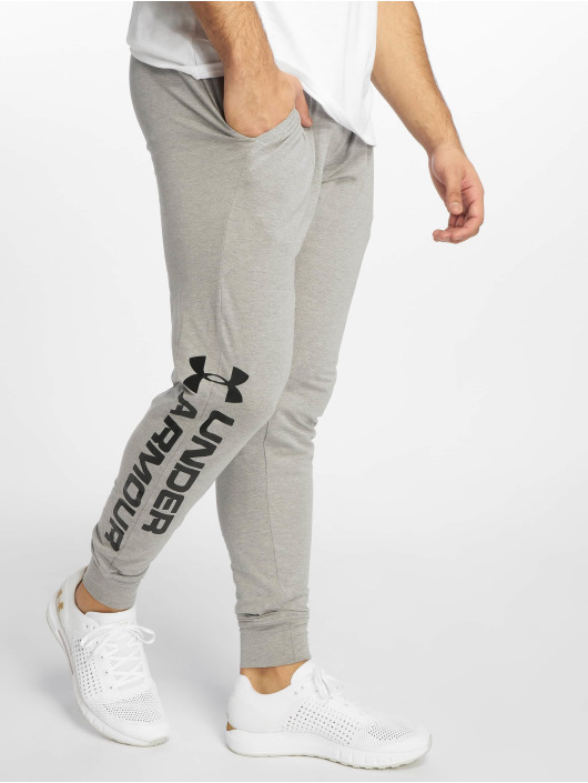 Under Armour tepláky Sportstyle Cotton Graphic šedá