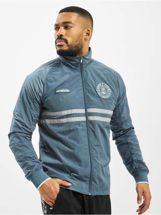 UNFAIR ATHLETICS Демисезонная куртка Light Carbon синий
