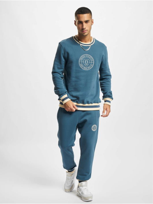 UNFAIR ATHLETICS Joggingbyxor Fraternity blå