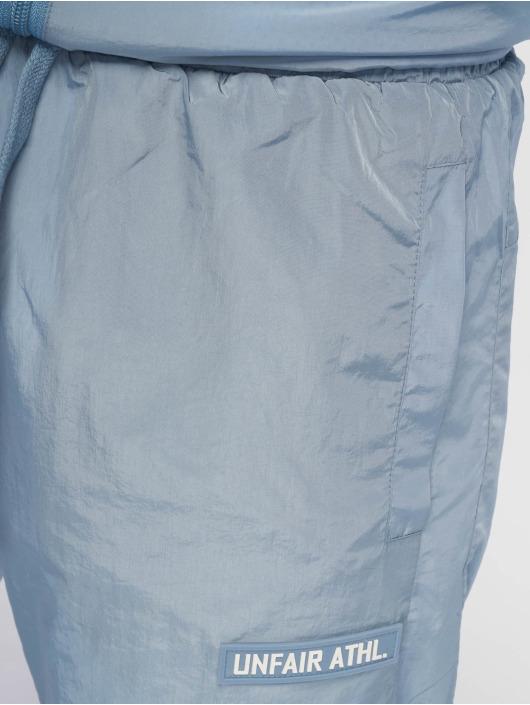 UNFAIR ATHLETICS Jogginghose Light Carbon Windrunner blau
