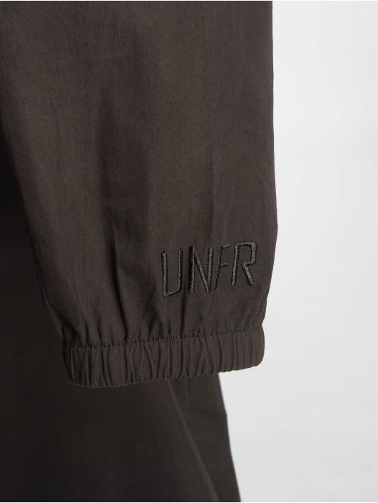 UNFAIR ATHLETICS Übergangsjacke Storm Overshirt schwarz