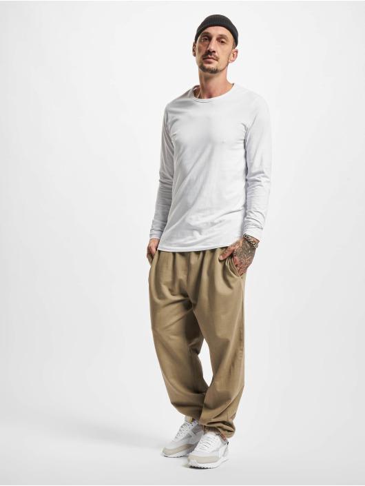 Urban Classics Jogging kalhoty Overdyed hnědožlutý