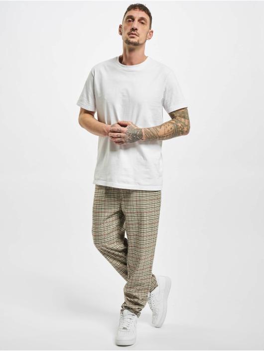 Urban Classics Spodnie do joggingu Tapered Check bezowy