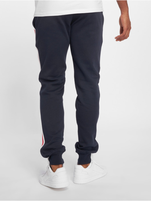 Urban Classics Spodnie do joggingu 3-Tone Side Stripe Terry niebieski