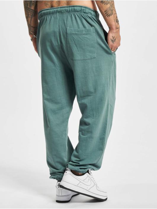 Urban Classics Spodnie do joggingu Overdyed niebieski