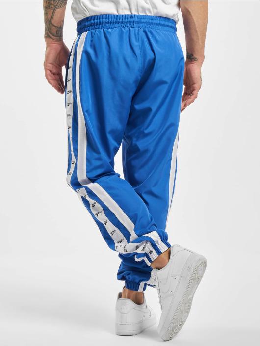 VSCT Clubwear Spodnie do joggingu MC Nylon Striped niebieski