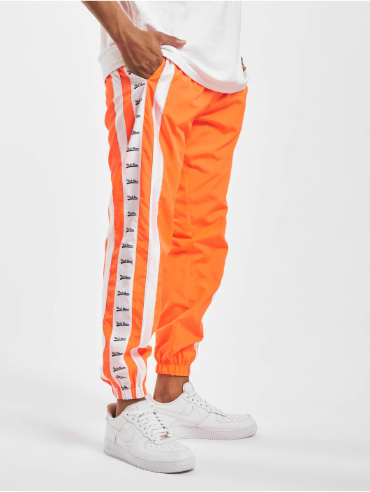 VSCT Clubwear Spodnie do joggingu MC Nylon Striped pomaranczowy