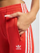 adidas Originals Joggingbyxor SST PB röd