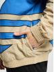 adidas Originals Kurtki przejściowe Big Trefoil Outline Woven bialy