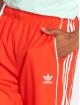 adidas originals Spodnie do joggingu Auth Wind czerwony 1