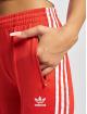 adidas Originals Spodnie do joggingu SST PB czerwony