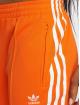 adidas originals Spodnie do joggingu Sst Tp pomaranczowy 3