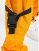Karl Kani Spodnie Chino/Cargo Kk Signature Crincle Nylon pomaranczowy