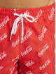 Merchcode Badeshorts Coca Cola Logo All Over Print red