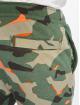 Nike Spodnie do joggingu Club Camo FT zielony 4