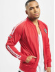 UNFAIR ATHLETICS Chaqueta de entretiempo Dmwu Pocket rojo