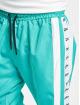 VSCT Clubwear Jogging kalhoty MC Nylon Striped tyrkysový