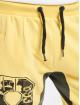 Yakuza Verryttelyhousut Badge keltainen