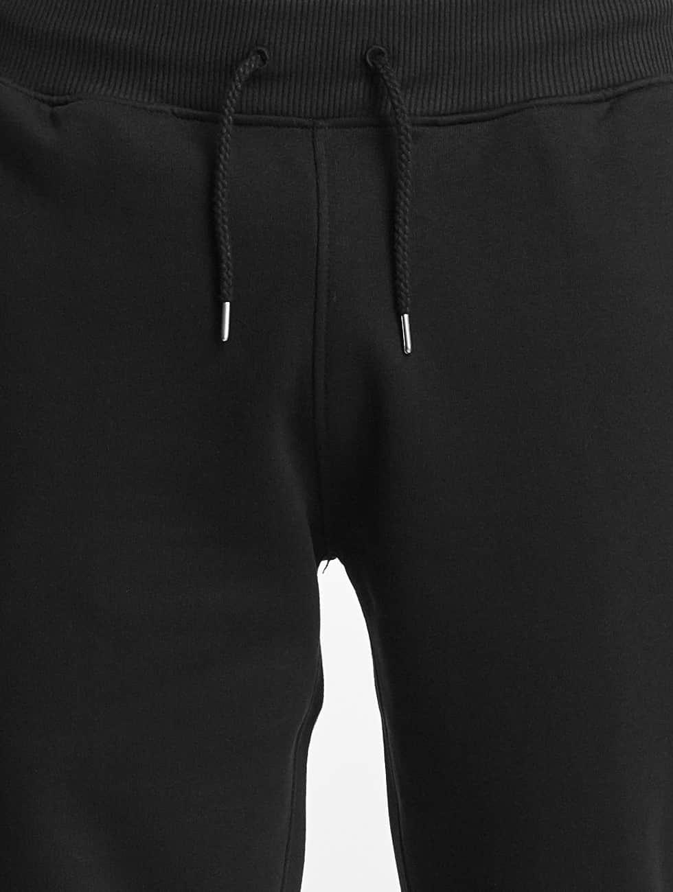 New Era Spodnie do joggingu Oakland Raiders Fleece czarny