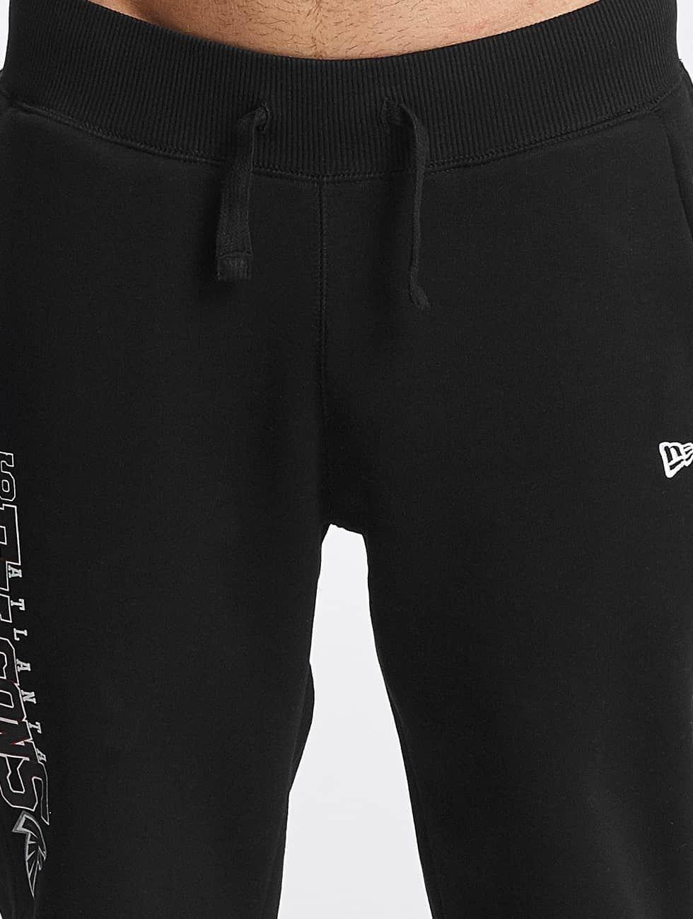 New Era Spodnie do joggingu Team Wordmark Atlanta Falcons Tracker czarny