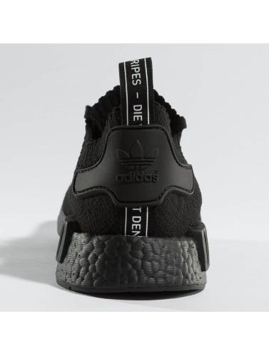 adidas originals Hombres Zapatillas de deporte NMD_R1 Primeknit in negro