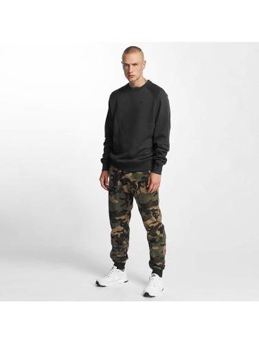 New Era Hombres Jersey Essential Raglan in gris