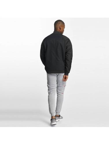 Nike Hombres Cazadora bomber Sportswear in negro