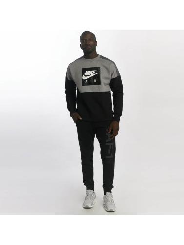 Nike Hombres Jersey Sportswear in gris