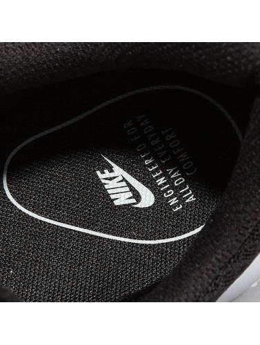 Nike Mujeres Zapatillas de deporte Tanjun in negro