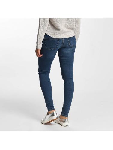 billig Kan Bråkete Kvinner I Blå Skinny Jeans Nmeve billig virkelig oppdatert BF4LN