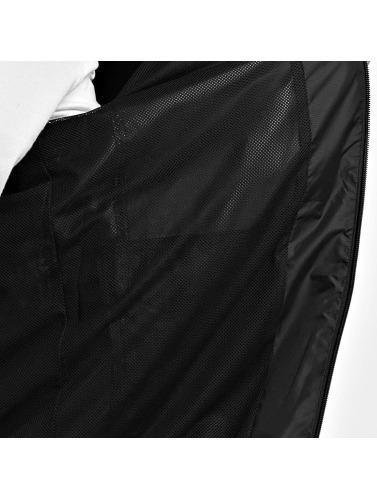Reebok Hombres Chaqueta de entretiempo F in negro