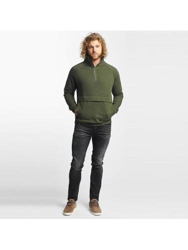 Reell Jeans Hombres Jersey Track Half Zip in oliva