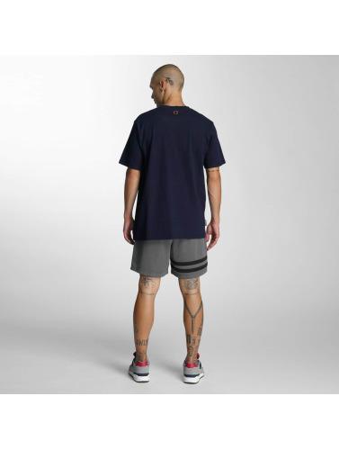 UNFAIR ATHLETICS Hombres Camiseta Sealed in azul