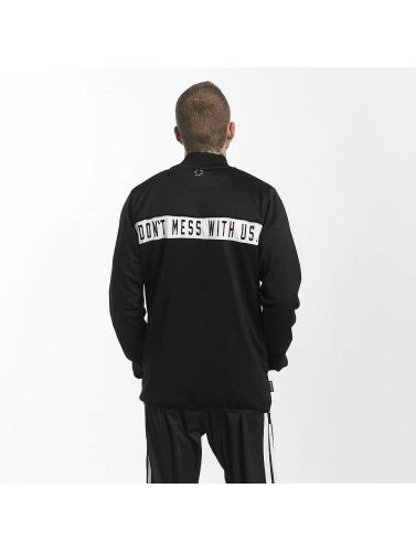 UNFAIR ATHLETICS Hombres Chaqueta de entretiempo DMWU XTD in negro