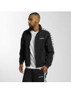 adidas Демисезонная куртка TNT Tape Wind черный