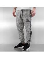 adidas Спортивные брюки CLFN French Terry серый